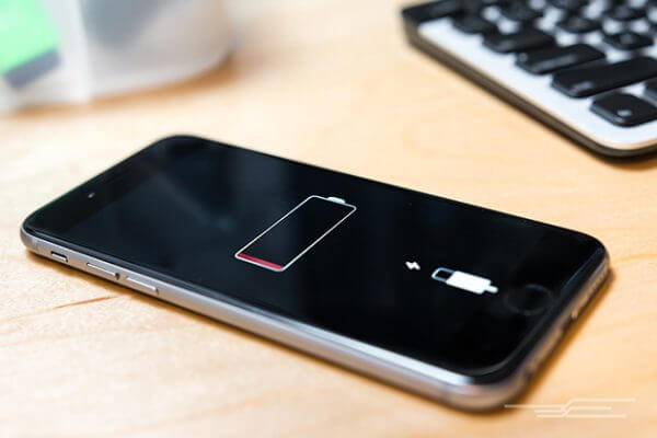 an iphone with the battery low indicator on the screen