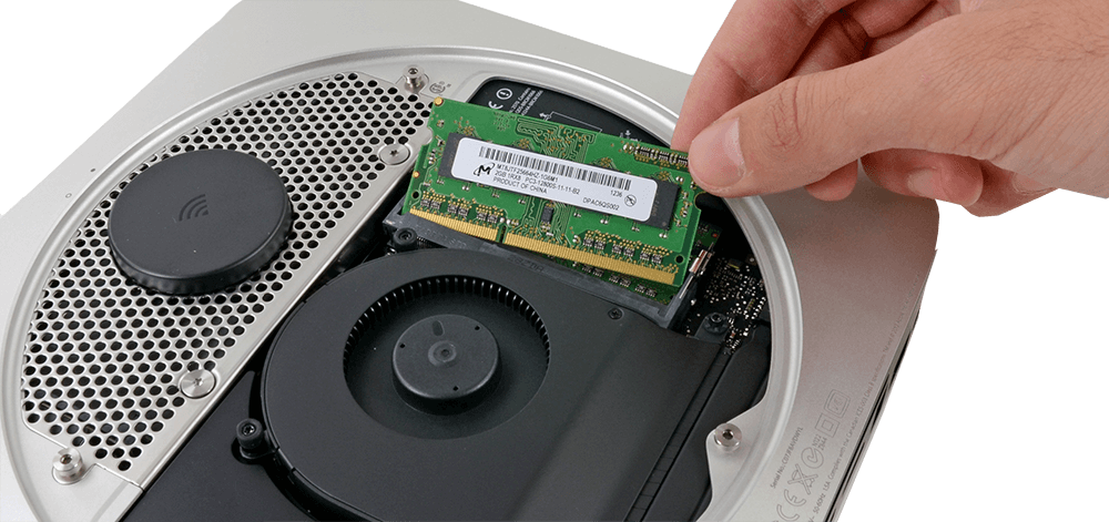 One of our Apple certified engineers, installing memory into a Mac Mini