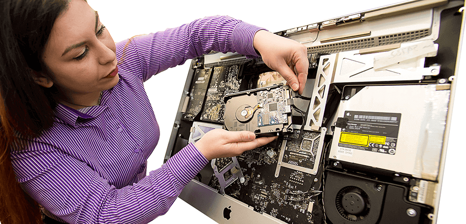 One of our Apple certified engineers, installing a storage drive upgrade on an iMac