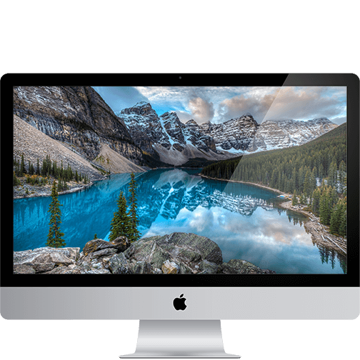 an iMac showing a high-sierra wallpaper.
